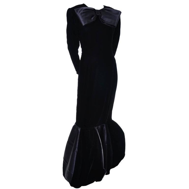 This absolutely stunning vintage Givenchy evening gown was purchased at I Magnin in the 1980's. This avant garde evening gown has a pleated structural flounce at the hemline with velvet and taffeta panels that almost form a balloon hem, and a giant
