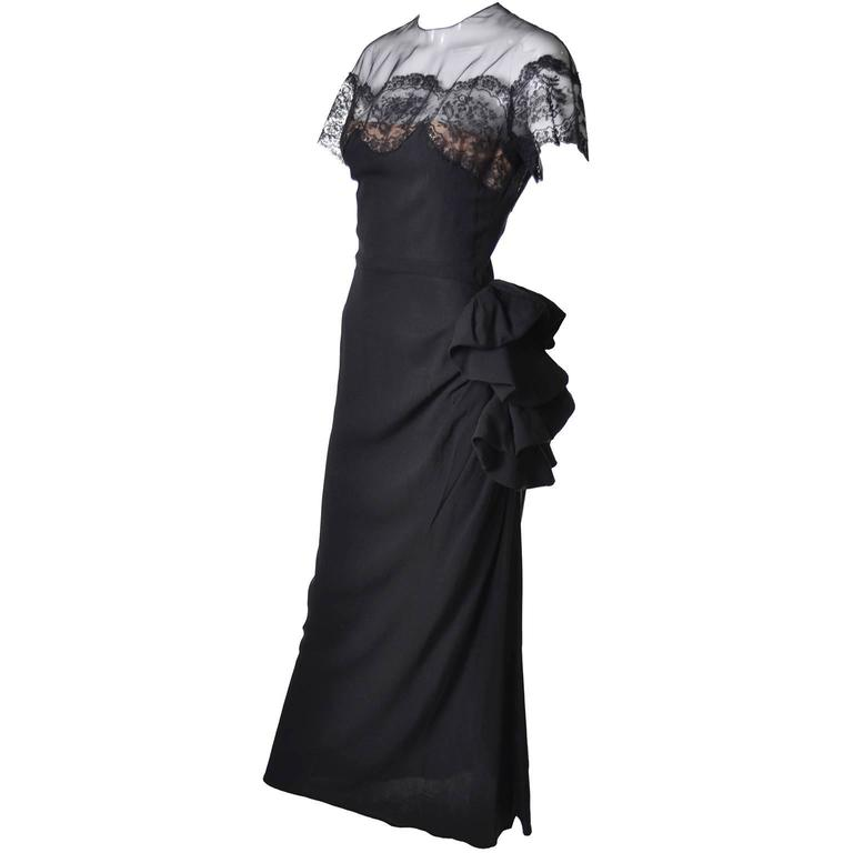 This sensational 1940's Peggy Hunt vintage black rayon crepe dress has a pretty organza illusion bodice and fine lace trim. Her 1940's dresses are rare to find and I was so thrilled to acquire this one in such good condition! The dress has a side