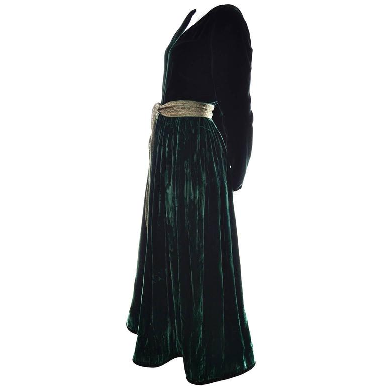 This luxurious green velvet evening gown was designed by Oscar de la Renta and has the Oscar de la Renta Studio label.  The bodice is smooth deep green velvet and the skirt is satin backed crushed green velvet with deep green trim at the hem line.