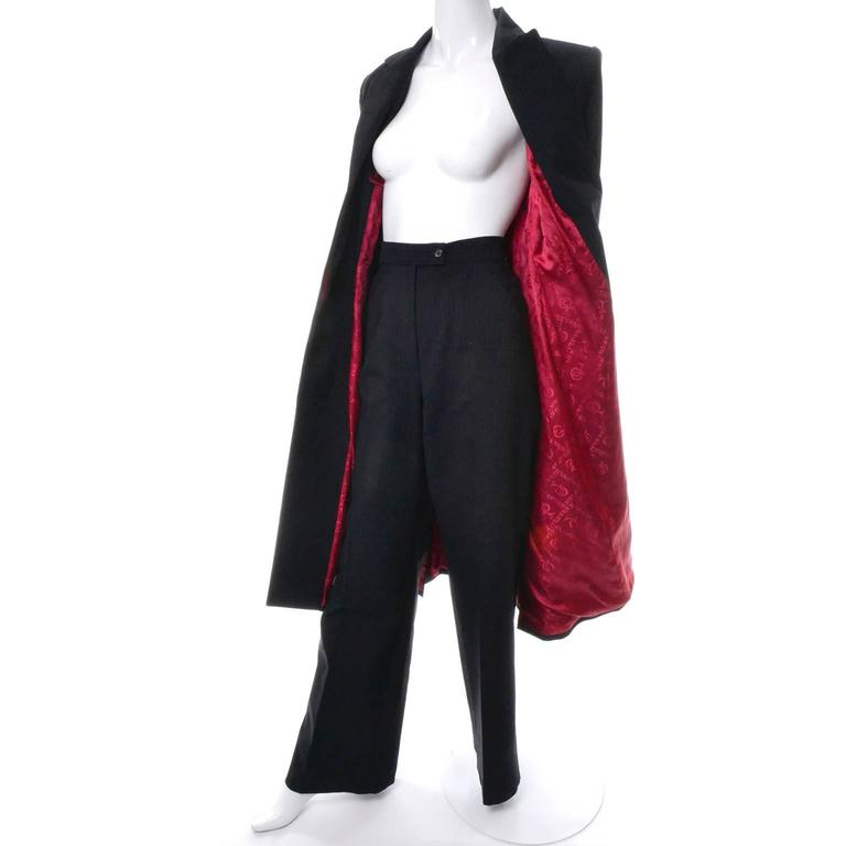 This very rare vintage Alexander McQueen Pant Suit appears to have never been worn and is from his 1998 RTW Fall Joan of Arc Collection.  The only photograph I could find isn't of great quality but I have included it in the images. This black suit