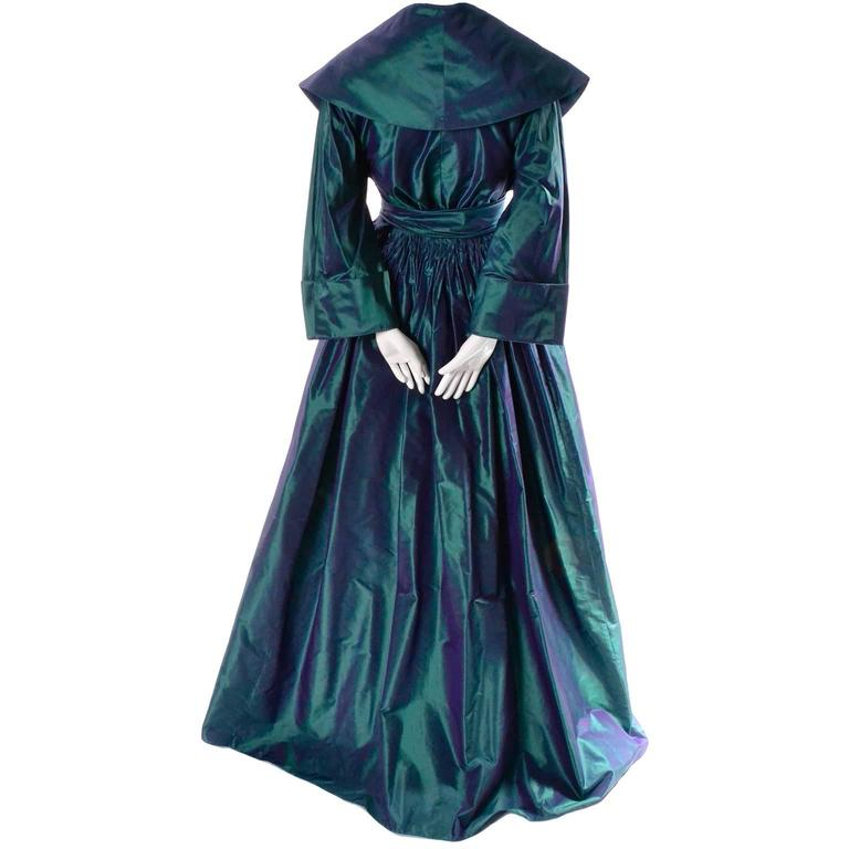 This extraordinary vintage evening gown was designed by Carolyne Roehm and purchased at Bergdorf Goodman in the 1980's.  This stunning iridescent peacock blue green dress is made of a gorgeous taffeta and it closes at the waist with a snap and hook