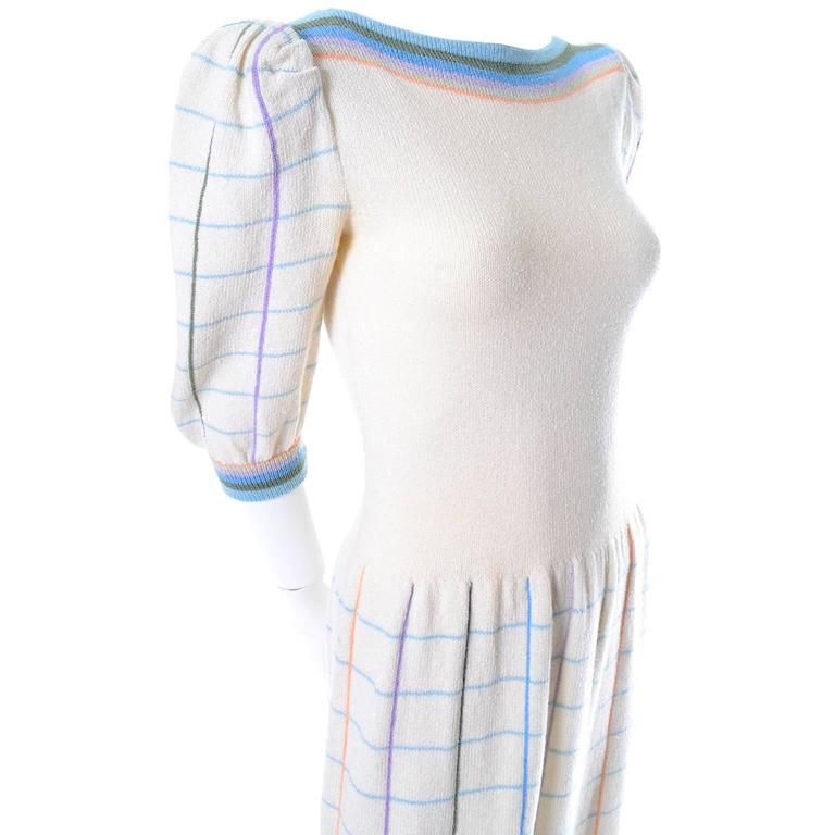This adorable creamy winter white Adolfo vintage dress was purchased at I Magnin in the 1970's.  The dress is made of a wool/rayon blend knit and has pretty pastel window pane plaid on the skirt and sleeves, and pastel stripes on the collar and