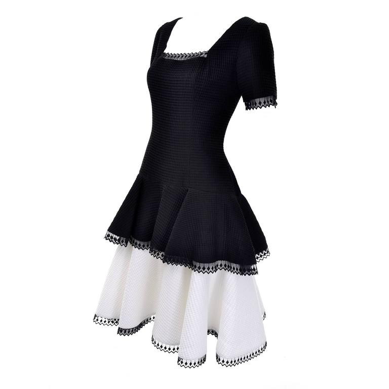 This vintage Victor Costa dress was purchased at the upscale boutique Lou Rose in the Montecito area of Santa Barbara in the 1980's. This black and white  waffle weave dress is lined and has pretty lace trim and a layered skirt.  This dress is