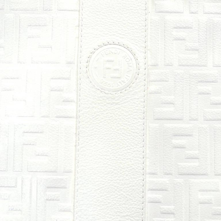 This large clutch style vintage white leather Fendi handbag has the F logo throughout the leather and measures 10 by 15