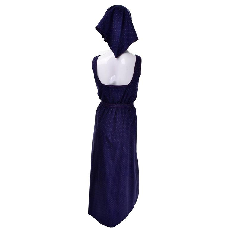 This is an adorable Albert Nipon navy blue vintage 1970's maxi dress with small red polka dots and a matching kerchief style head scarf! The waist tie is sewn in and ties in front. The buttons go all the way to the bottom, and there are two large