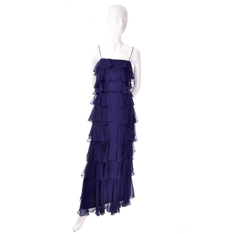 This is a great vintage Fred Perlberg navy blue silk chiffon ruffled vintage dress with a matching shawl. This dramatic long navy maxi dress has a sheer chiffon tiered ruffle overlay and spaghetti straps. Zips up the back and comes with a sheer