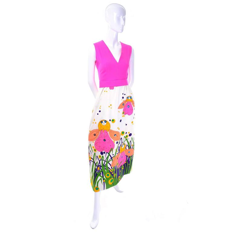This vintage dress was designed by Gino Charles in the 1960's.This fabulous sleeveless maxi dress has a sensational rare design with a bright pink bodice and a v neck. The long skirt of the dress has polka dots, and bright pink, yellow and orange