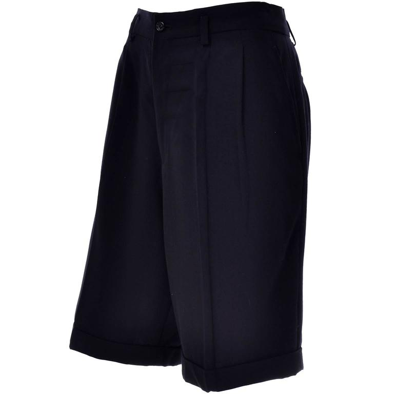 These vintage Comme des Garçons long shorts are 100% wool and were made in Japan. They are fully lined and meant to be worn oversized. Keep in mind that the measurements may seem a little larger because they were meant to be worn oversized with a
