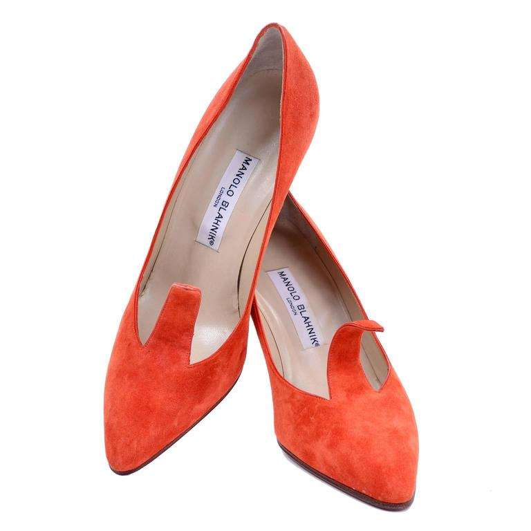 We adore these orange suede vintage heels by Manolo Blahnik London, with a cutout pointed strip on the upper that is adjustable! You can form it to your foot, or curl it to your liking. These shoes have a rounded pointed toe. They have leather soles