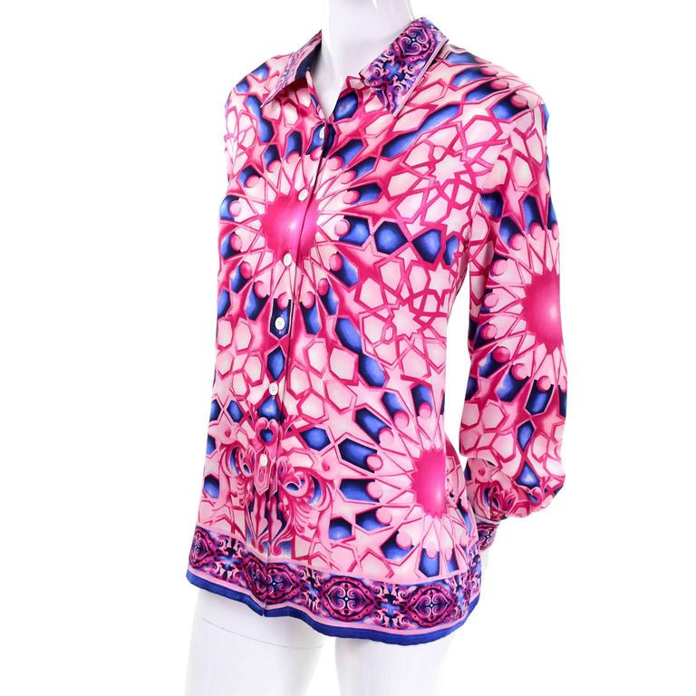 This vintage silk Escada Blouse has a Versace - esque vibe. The luxurious silk fabric has a pink and blue abstract geometric design and is labeled a size 40.  BUST - 40