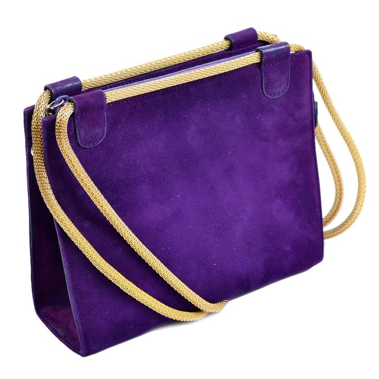 This is a fabulous vintage handbag designed by Walter Steiger. We have always loved Walter Steiger shoes and were thrilled to come across his handbags! The bag measures 6.5