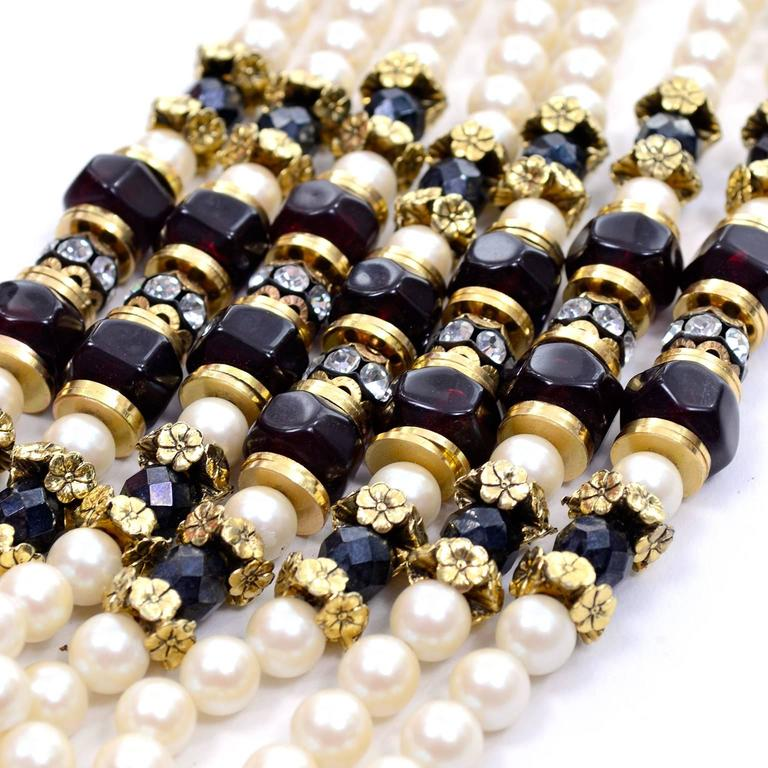 This is a fabulous vintage 1960's 7 strand necklace with faux pearls, black faceted beads, gold spacers and rhinestones.  The necklace is 20