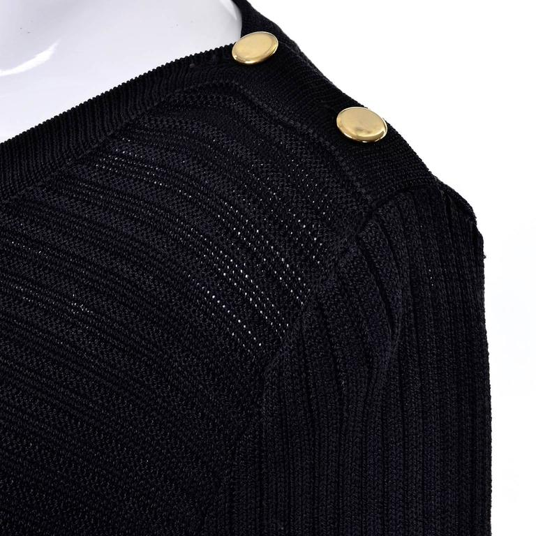 This is a gorgeous ribbed stretch knit vintage black dress from Yves Saint Laurent.  The dress has buttons on the shoulder and the pattern of the fabric creates an inverted triangle on the bodice.  This is a fabulous bodycon dress that is in