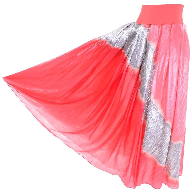 This is an exquisite 1990's long vintage skirt from Donna Karan that is so hard to describe with words!  This incredible luxe evening skirt is made of organza and lame. The skirt has a silk jersey waistband and it comes with a fringed ultra fine net