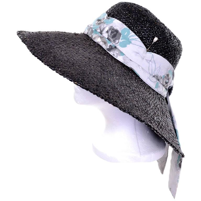 This mid century vintage black painted straw hat was designed by Mr. Blackwell. Mr. Blackwell made hats for his socialite female friends and celebrities and this is the only hat designed by him that I've ever seen. The hat has a scarf and buckle and