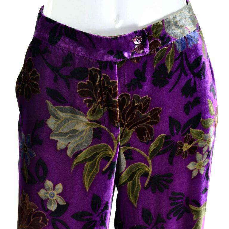 These luxuriously soft purple floral velvet pants from Etro are made of a silk and rayon blend fabric in shades of purple, green and brown.  Perfect for Fall and winter, these wide legged pants have side slit pockets and they close with a front