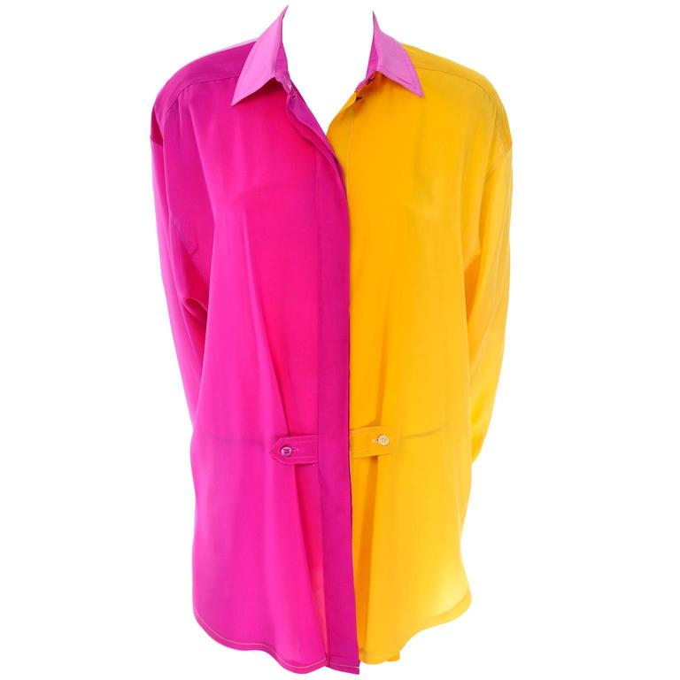 This silk Escada vintage oversized 1980s blouse is color blocked with shades of yellow and pink and the back has a beautfiul  fading ombre effect. There are pink buttons up the front that are hidden except for the top two and there are two button