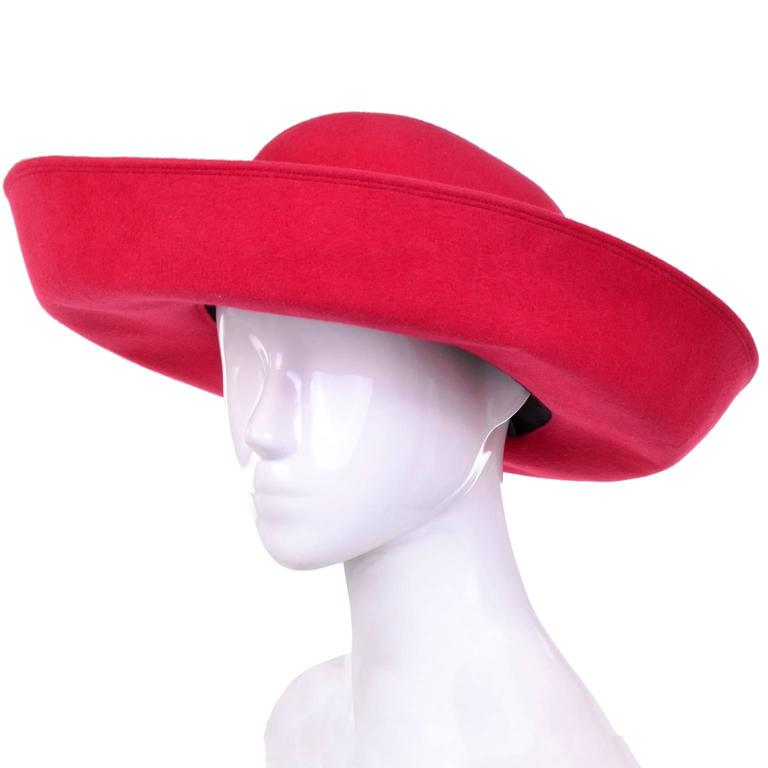 This is a vintage Patricia Underwood wide brim scarlet red wool hat that was never worn and still has its original Bergdorf Goodman tag attached. The hat measures  21