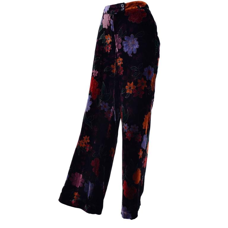 These elegant floral velvet pants from Etro are made of a Viscoise (rayon) and silk blend fabric in shades of black, deep burgundy, blue and rich deep rust..  These higher waisted, wide legged pants have side slit pockets and they close with a front