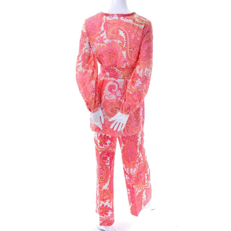 This 2 piece orange and pink paisley pants and tunic ensemble is another one that came from our favorite estate of all time. The outfit only has a small size label, but all of the clothing and accessories from this estate were from important