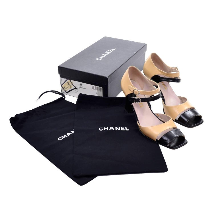 These late 1980's classic two tone beige and black Chanel shoes come with their original box and shoe bags! These shoes are from an incredible estate of beautiful designer vintage shoes and clothing.  The shoes are labeled a size 37.5 and the