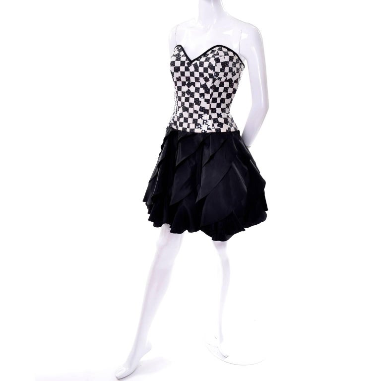 This amazing vintage Lillie Rubin party dress is from the 1980's and has a cotton black and ivory checked bodice that is covered with clear and pale ivory sequins.  The dress has stays in the bodice, a tiered ruffled taffeta skirt and a zipper up