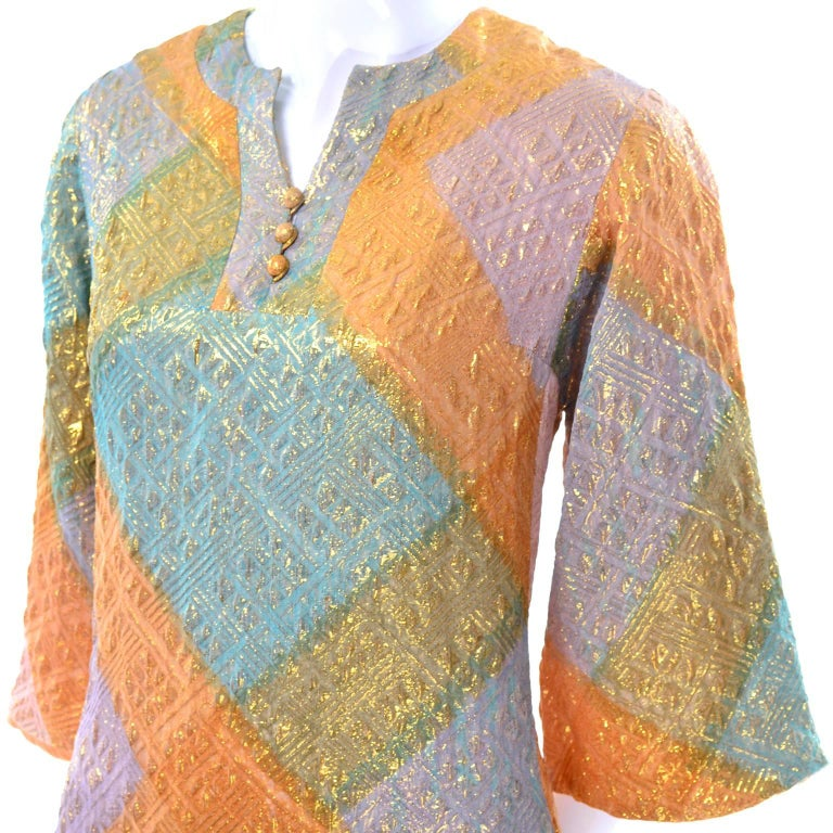 We love this pretty Dynasty long dress in metallic shades of blue, orange, purple, pink and gold!  The caftan style dress is fully lined and has 14
