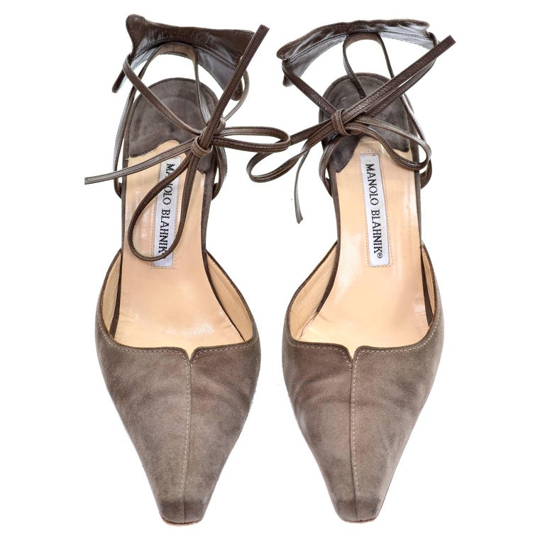 These vintage Manolo Blahnik brownish taupe suede shoes have fabulous leather ankle straps that have wide butterfly shaped suede at the back of the heels . The shoes have the expected sole scuffs, but are otherwise in very good condition and appear