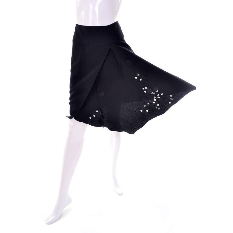 This pretty vintage black silk and rayon skirt was designed by Christian Lacroix and made in France in the 1990's.  The skirt closes with a side zip, is embellished with appliques that are embroidered and covered in square sequins. and is
