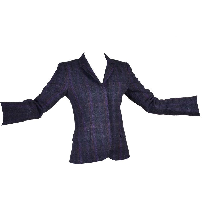 This is a fab purple, charcoal and red plaid cotton and wool blazer by Alexander McQueen for the McQ collection. Gorgeous construction on this fitted jacket, with hidden buttons and a false breast pocket, and two false flap pockets that keep the