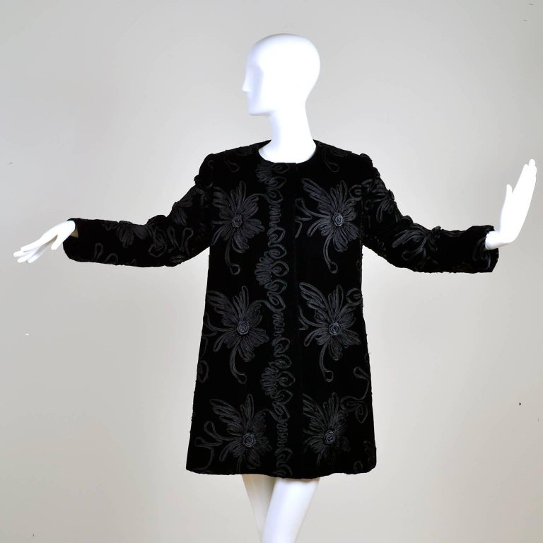 This Estevez couture black vintage evening coat is a really spectacular piece!  The coat is made of black velvet and it has incredible black soutache trim that forms flowers throughout!  The jacket has shoulder pads, a single snap closure at the