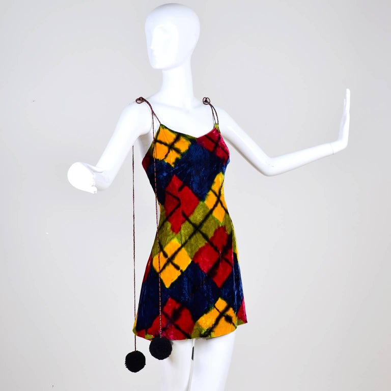 This fabulous vintage dress was designed by Todd Oldham for his 1994/95 Fall/Winter collection. The incredible dress is a harlequin or argyle printed rayon velvet with a back zipper. The dress is lined in a gorgeous tye dyed silk. The long ties can