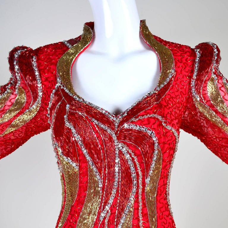 This sensational vintage dress was designed by Oleg Cassini and it has the Black Tie label.  This truly stunning dress is beautifully beaded and was purchased at Neiman Marcus in the 1980's.  The dress has red, gold and silver beads, long sleeves,