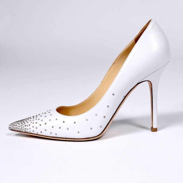 These beautiful Jimmy Choo white leather Abel heels with silver studs are new in their original box.  The shoes are marked a size 37.5 and have 4