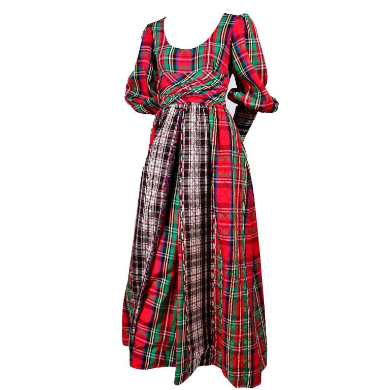 This is a fabulous Leo Narducci jumpsuit with illusion overdress in red, green, blue, yellow, black and white quilted plaid. This wide leg jumpsuit appears to have an open front dress over the front, but it is actually just an extension of the wide