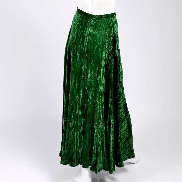 This is a fabulous late 1970's YSL vintage skirt in green crushed velvet from Yves Saint Laurent.  This iconic peasant style Russian inspired skirt is labeled a French size 36 and fits like a modern day US size 2.  This great maxi skirt closes with