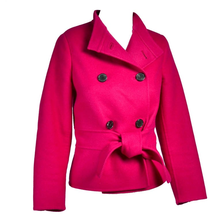This beautiful Valentino jacket is in a raspberry red wool angora blend and is lined in silk.  The jacket has a fabric belt and is double breasted.  The Valentino L'Amour label reads:  Your eyes are the eyes of a woman in love. Excellent condition