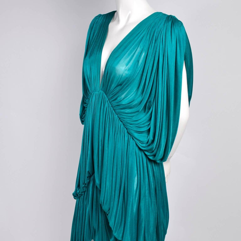 This is an outstanding, rare vintage dress from one of our favorite designers, Norma Kamali. This Norma Kamali OMO butterfly dress is from 1978 and a version of this dress is in the MET museum. This dress has three tiers of gorgeous pleated fine