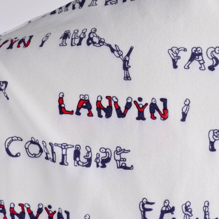 """This amazing 1970's vintage Lanvin white pantsuit is comprised of a blazer and pants in a novelty print that is made of small people in red and blue, spelling out various words; Lanvin"""" """"Love"""" """"Paris"""" """"Summer"""""""