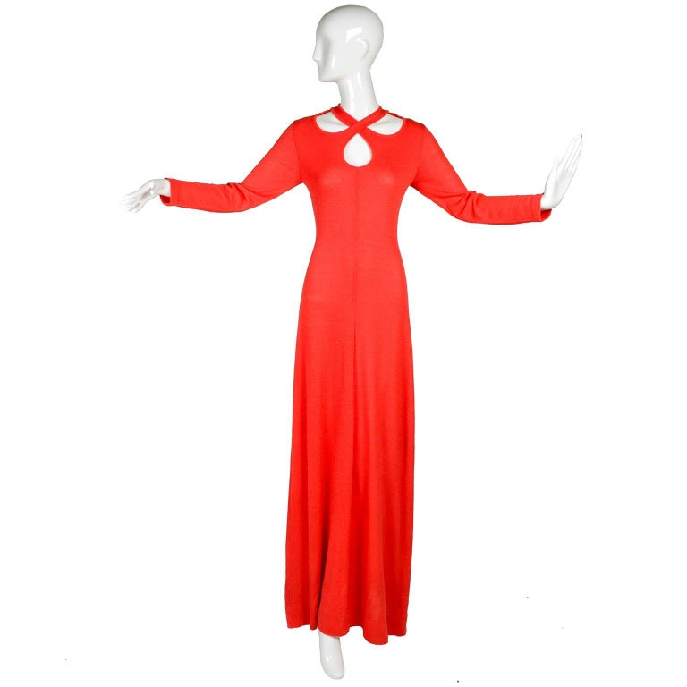 This is a wonderful 1970's Arbe Imports orange red stretch knit maxi dress with a criss crossing bodice leaving large keyhole cutouts. This long sleeve dress zips up the back. Made in Italy. Marked as a size 12, and measures like a modern US size