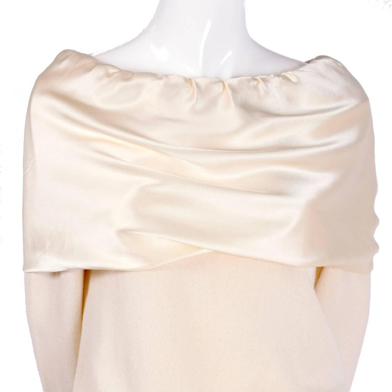 This is a fabulous cream cashmere sweater from Dolce & Gabbana with a silk satin shoulder shawl