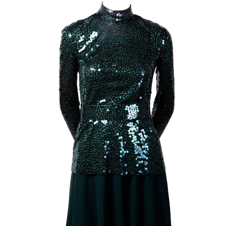 We are very pleased to offer this  vintage Norman Norell Evening ensemble. This is a 2 piece evening dress with a green knit skirt and a gorgeous green sequin covered long sleeved top with a green sequin belt.   Please scroll down and press