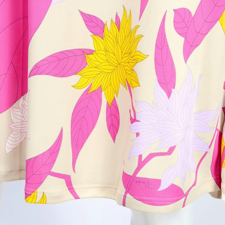 This is a Pucci rayon jersey floral leaf print dress in shades of pink, cream, yellow and lavender.  The dress was designed by Matthew Williamson for Pucci and made in Italy in 2009 and is labeled an Italian size 44, French size 40, US size 10, and