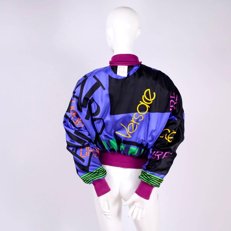 This sensational vintage Versace jacket was designed by Gianni Versace in the 1980's. The jacket is pink suede but the back is a panel of fabric printed with images of very stylish 1980's men. The inside is lined with a patterned silk fabric with