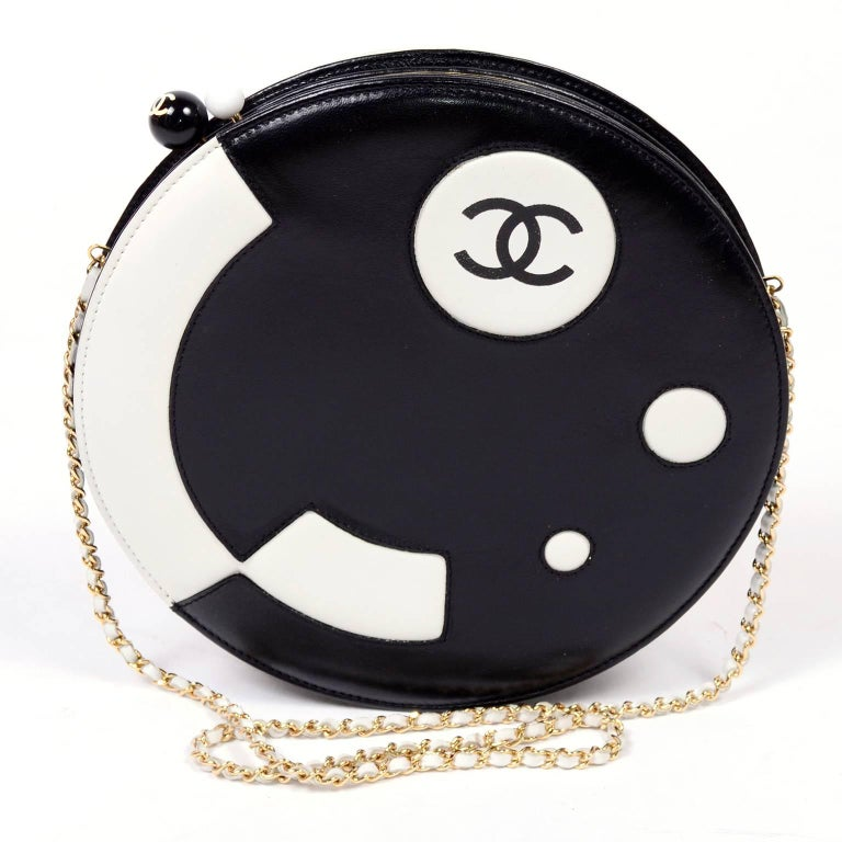 This gorgeous Chanel Shoulder bag is stunning with its modern futuristic pattern and circular shape.  This high contrast round black and white lambskin leather handbag is from Chanel's 2003 - 2004 collection. You can wear this handbag as a shoulder
