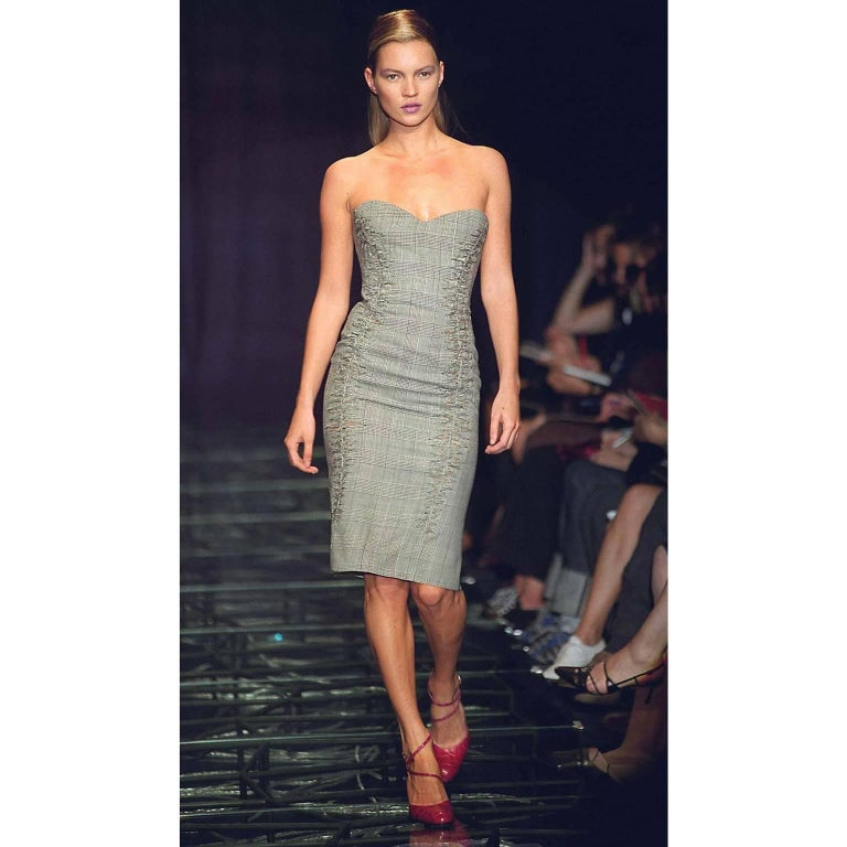 This famous dress is the same style as the one modeled by Kate Moss at the first show with Donatella Versace as creative director of Versace. This important, iconic dress was introduced as the first one on the runway during the show that was