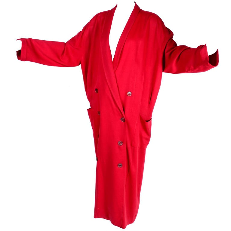 This is a stunning vintage oversized rich red coat from Norma Kamali. This stylish 80s double breasted long coat was designed in the 1980s and has rich red satin lining and front pockets.  The coat was made in the USA and is labeled a vintage size