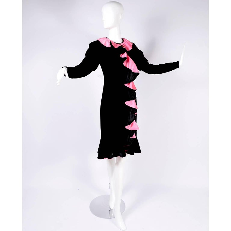 This is such a fun 1980's vintage dress from Oscar de la Renta in black velvet with gorgeous bright pink satin lined ruffles.  We are obsessed with the 80's and this dress is a perfect reason why!  The dress has a somewhat shift style fit, with a