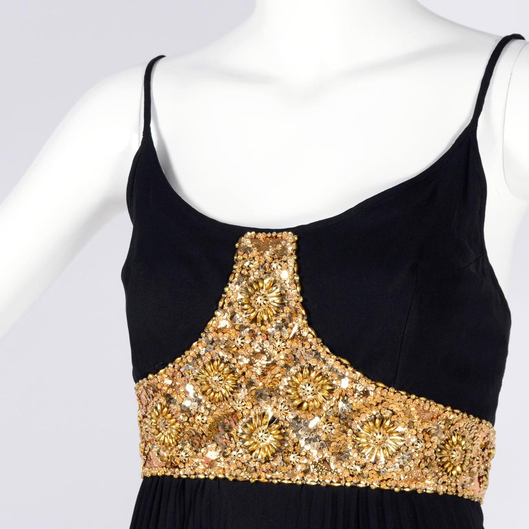 This stunning vintage Jean Patou dress would be perfect for that special event this summer!  This beautiful evening gown has gorgeous gold beads and sequins on the bodice & waistband, and a pleated, long skirt.  The dress has an empire waist and