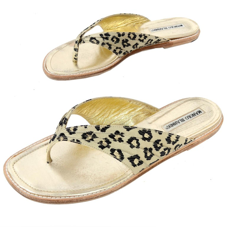 e266f3dff82cd1 ... These vintage Manolo Blahnik sandals have a cheetah print fabric upper  and a gold leather base ...